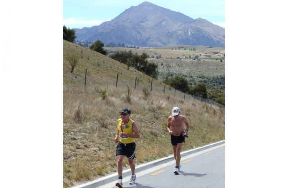 From left, Dunedin's Lindsay Dey leads his fellow 60-69 age group competitor Ralph Gill, also of...