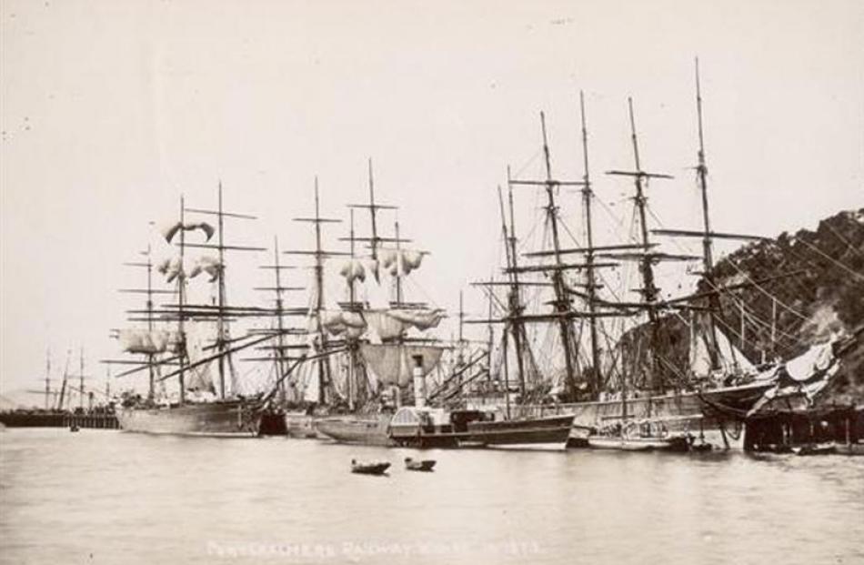 Sailing ships line up along the railway wharf, Port Chalmers, 1873. Photo by Da De Maus/Regional...