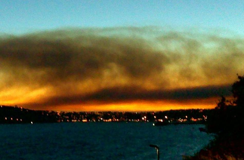 The combination of a setting sun and smoke from the fire provide a burst of colour. Reader photo...