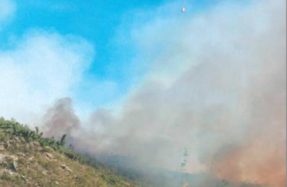 The fire captured by tourist Charlene Carpenter, a passenger on the Taieri Gorge train.
