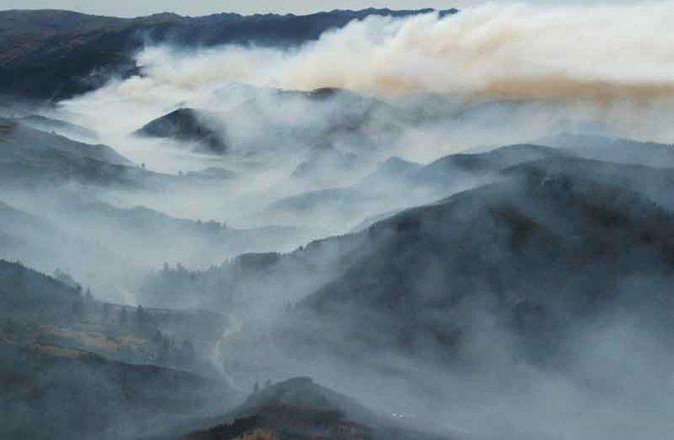 Smoke veils the Taieri Gorge valley system. Photo by Gerard O'Brien.