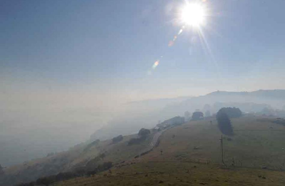 The sun dulled by smoke over the Otago Peninsula. Photo by Peter McIntosh.