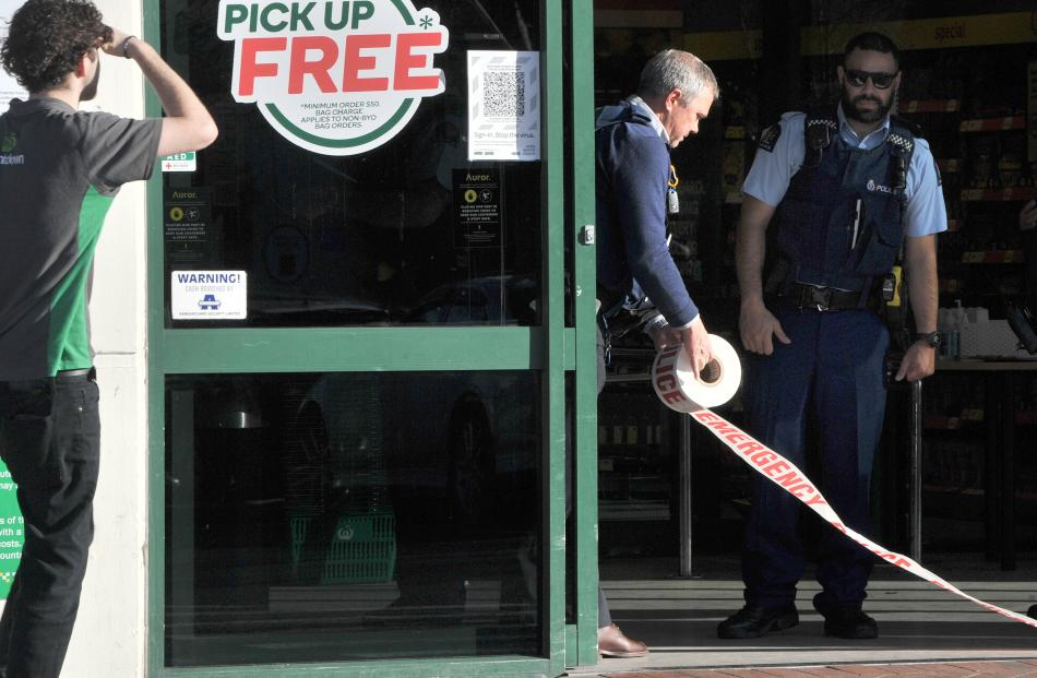 Police tape the front door of the supermarket after the stabbing attack today. Photo: Christine O'Connor