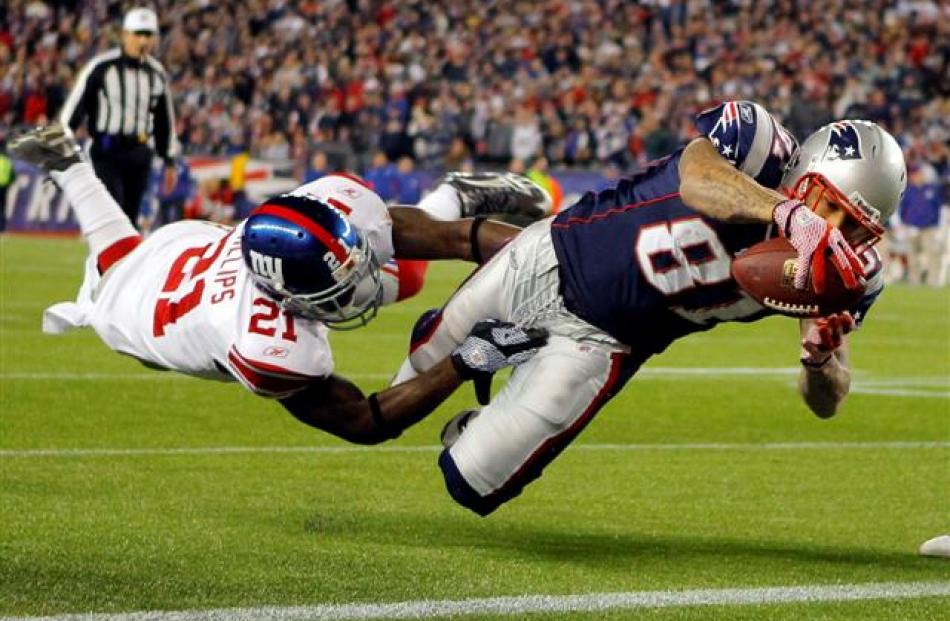 New England Patriots tight end Aaron Hernandez dives into the end zone for a touchdown through...