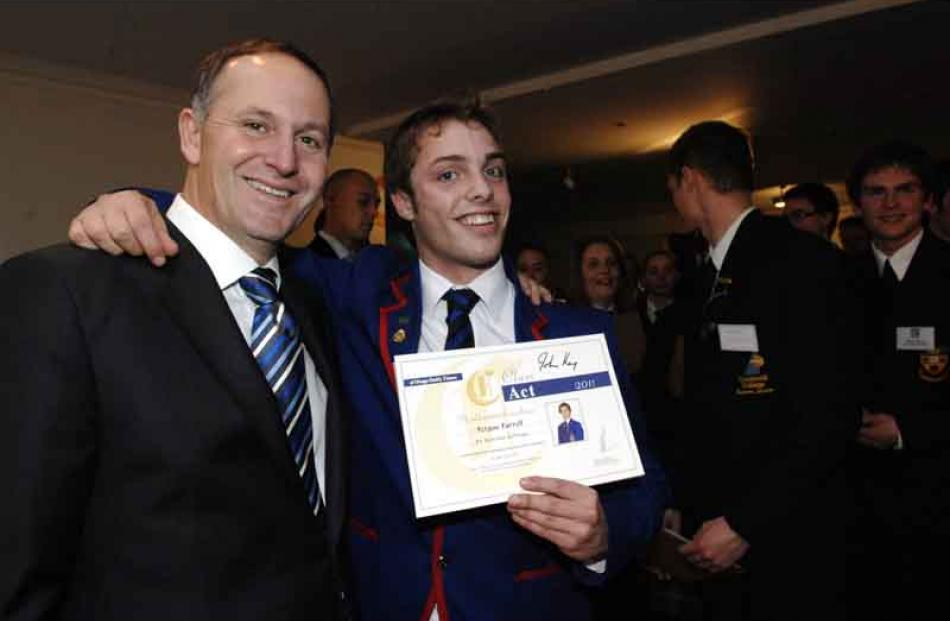 Fergus Farrell of St Kevin's College, Oamaru with his arm around Prime Minister John Key.