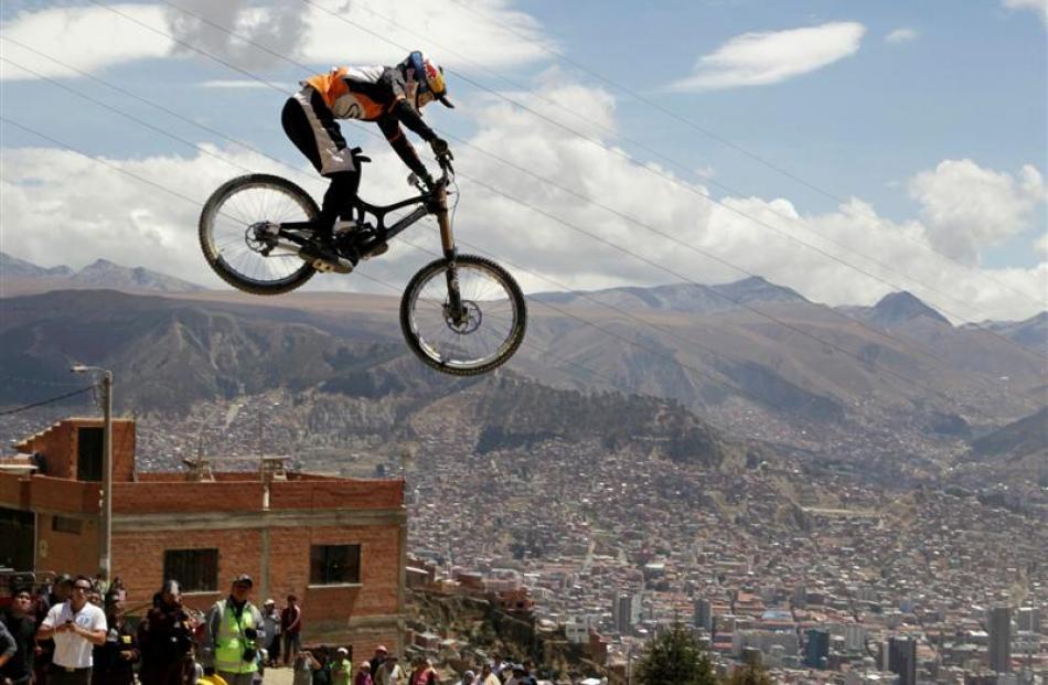Rider Bernardo Cruz of Brazil launches off a jump during the Descenso del Condor urban downhill...