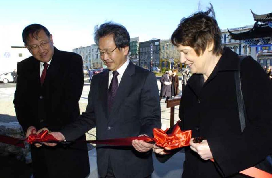 Dunedin Mayor Peter Chin is flanked by the Chinese ambassador Zhang Yuanyuan and Prime Minister...