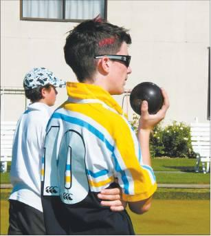 Eyeing it up: Craig James (16), of Cromwell College, works out his next move, with Alex Pasco in...