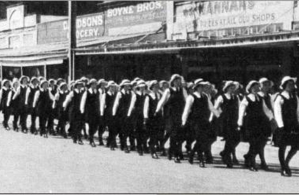 For the war: Shirley Blacklock (nee Fowler) leads the girls of Gore High School down Main St in...