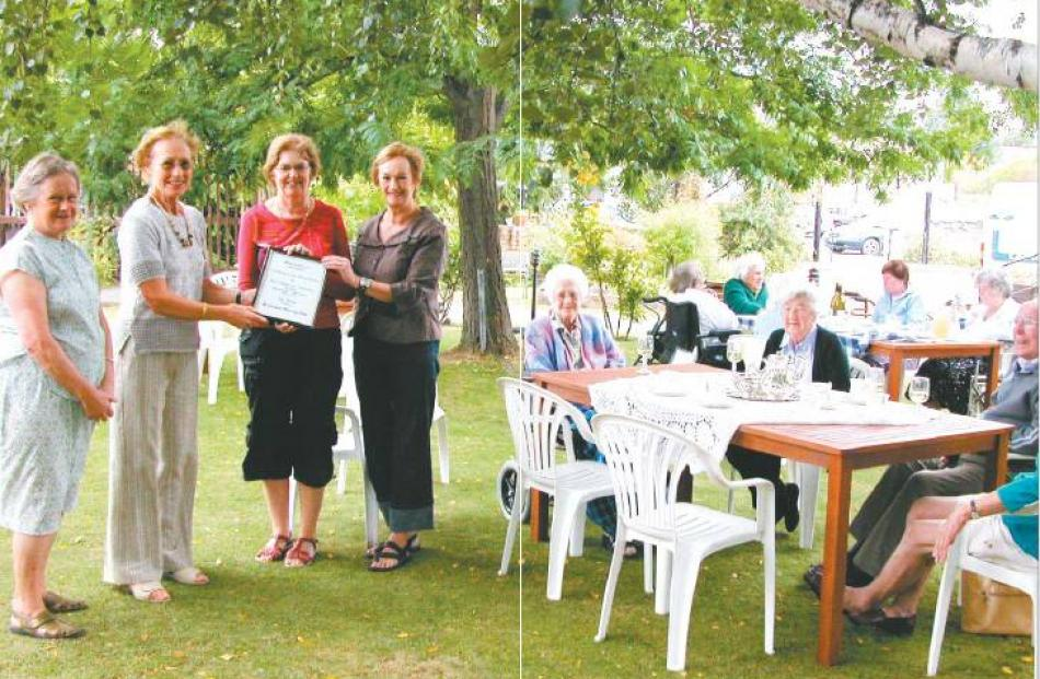 Special day: Castlewood residents enjoy afternoon tea in the garden as (from left) Alexandra...