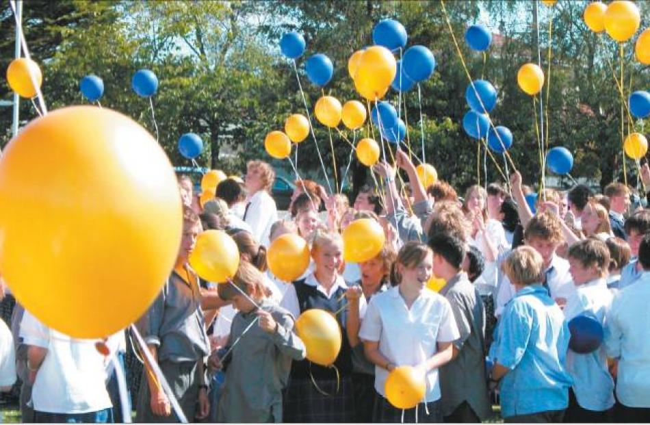 Take to the sky: Gore High School pupils with their balloons as part of the special ceremony held...