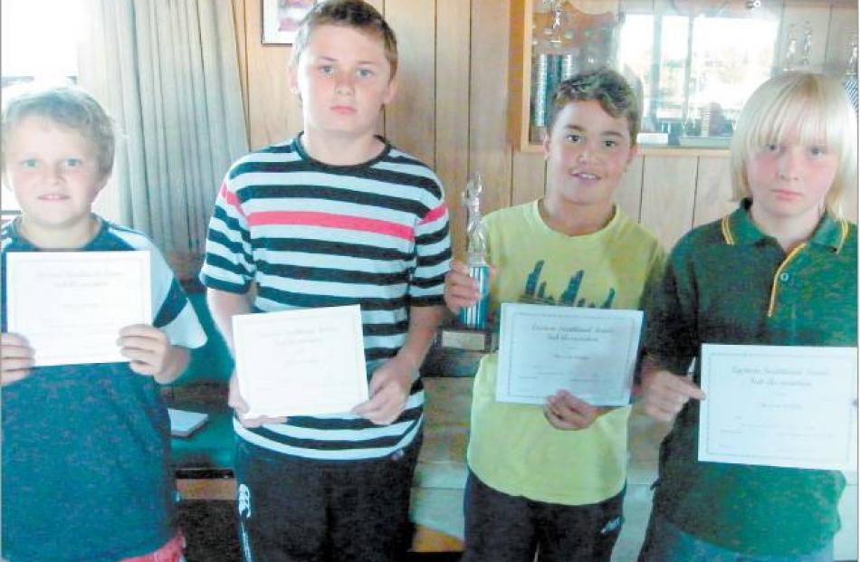 Proud winners of the C grade boys' title were Mataura players (from left), Ryan Kirk (10), Travis...