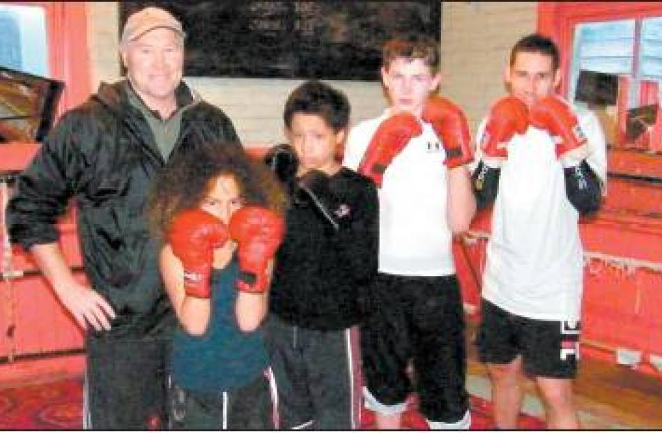 The line-up: Gore Boxing Club coach Russell Newton and young boxers (from left) Tiarete Wanahi ...