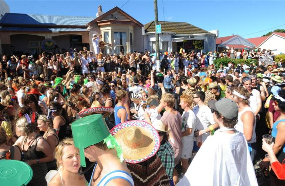 <b>2pm:</b> Revellers at the annual Hyde St keg party on Saturday.