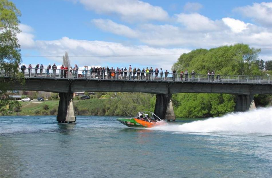 Crowds gathered on the Albert Town Bridge watch Otautau driver Roger Preston and navigator Damian...