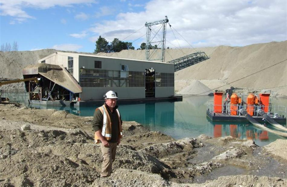 Mine manager Mark Coleman stands by L&M Mining's Earnscleugh gold dredge in mid-2011. Photo by...