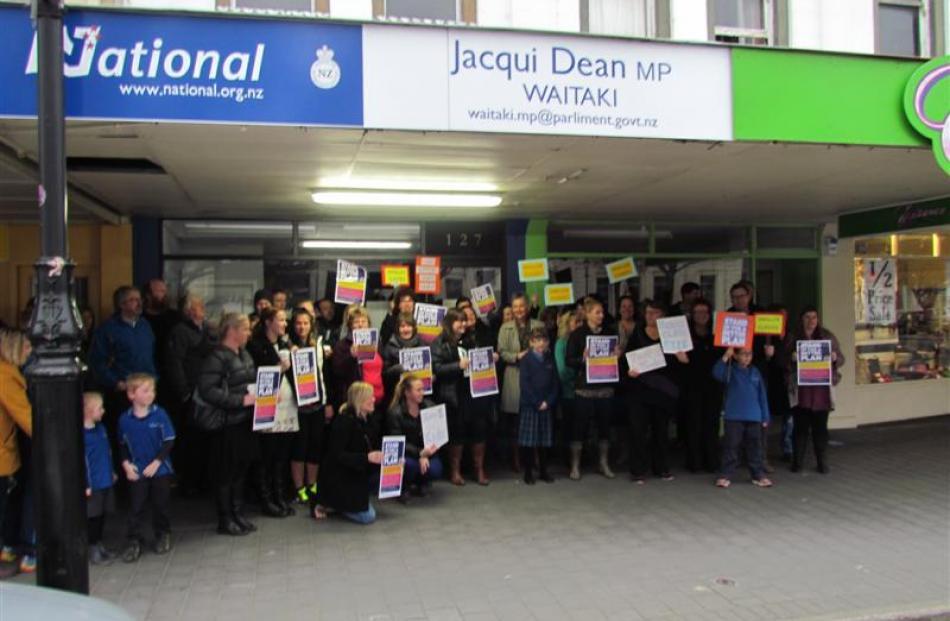 North Otago teachers gather outside Waitaki MP Jacqui Dean's office in Oamaru yesterday for a...