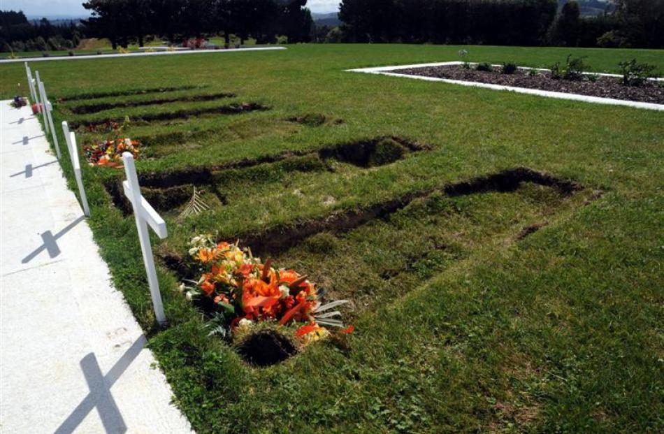 Soil will be added soon to sunken graves, including these  photographed at the Dunedin Cemetery...