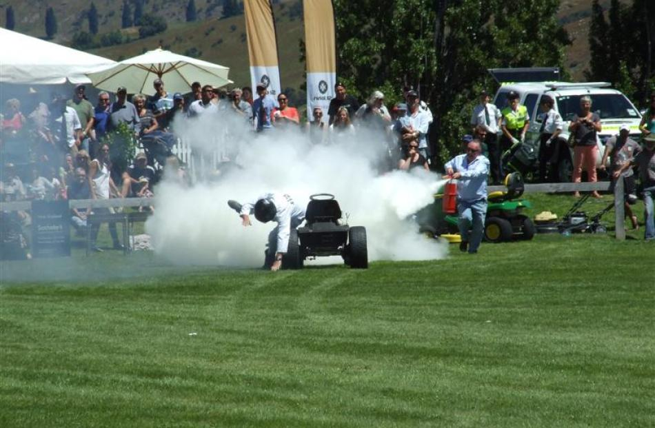 ''The Stig'' and his lawn mower are doused with a fire extinguisher after  an explosive finish in...
