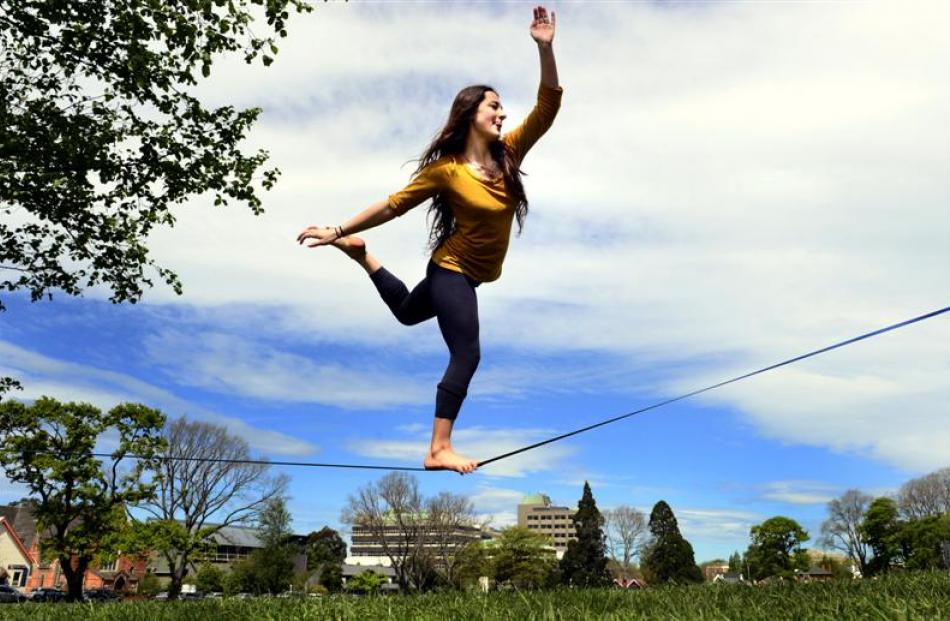 University of Otago anthropology student Michelle Henderson relaxes on a tightrope at the North...
