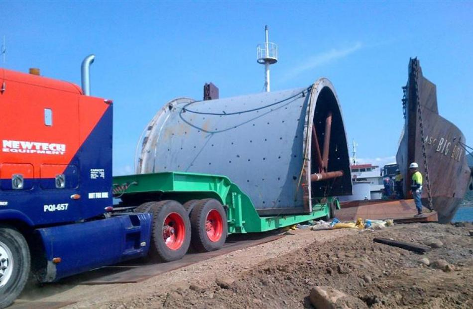 A ball mill shell arrives by ferry at Port Irene on Luzon island in the Philippines for transport...