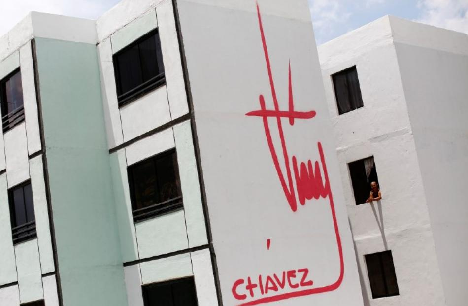 A building bears a design of the signature of late Venezuelan President Hugo Chavez in Ciudad...