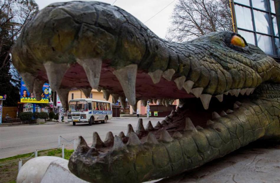 A bus drives past a tourist attraction in the Black Sea resort town of Alushta. Ukraine's Crimean...