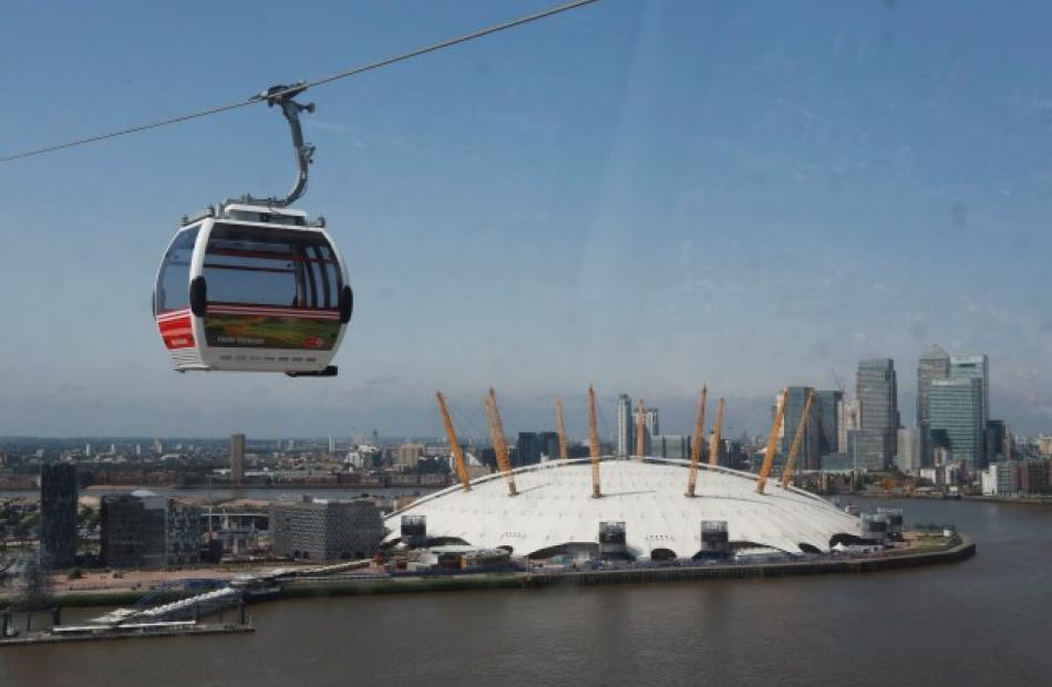 A cable car crosses the River Thames in London. REUTERS/Olivia Harris