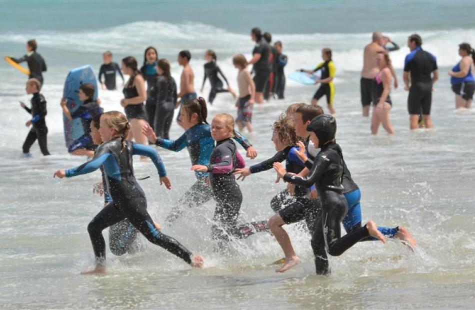 A class of ''Nippers'' from the St Clair Surf Life Saving Club join swimmers at St Clair Beach on...