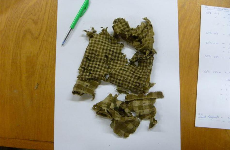 A cloth fragment removed from a hut in the Roxburgh Gorge. Photos by the Dept. of Conservation.