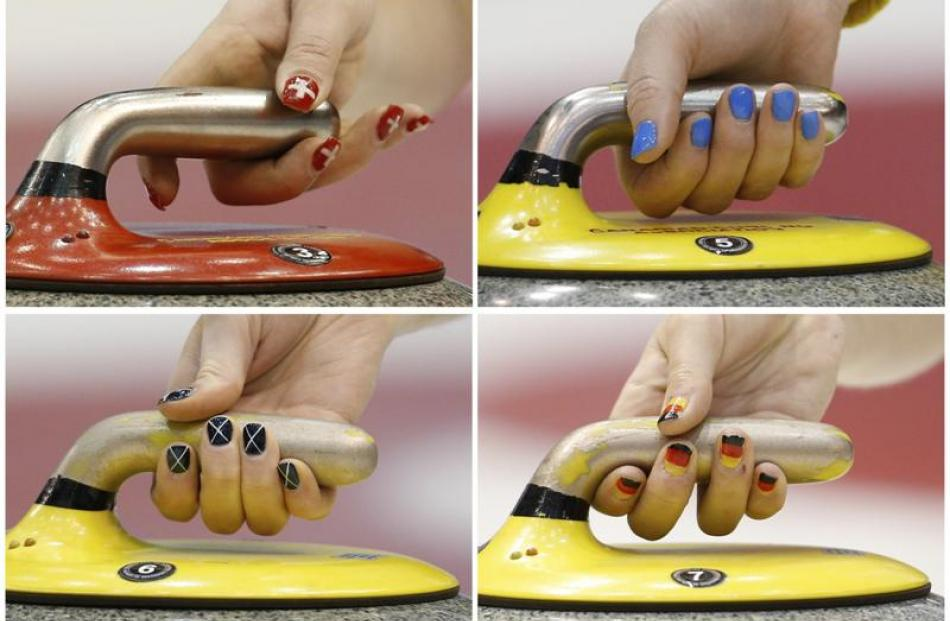 A combination photograph shows the painted nails of curlers while they deliver stones at the...