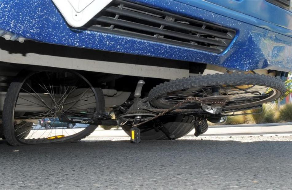 A cycle lies wedged under a  truck in Strathallan St, Dunedin, yesterday after the rider was...