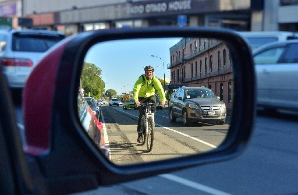 A cyclist makes his way along Cumberland St, Dunedin, in a cycle lane.