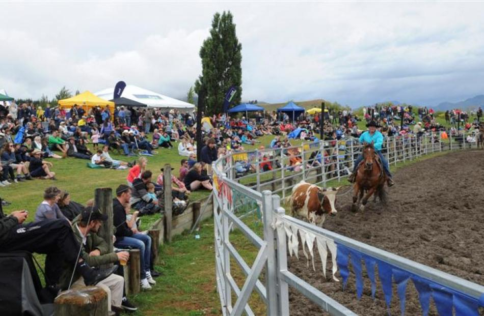 A damp but enthusiastic crowd watches the rodeo action.