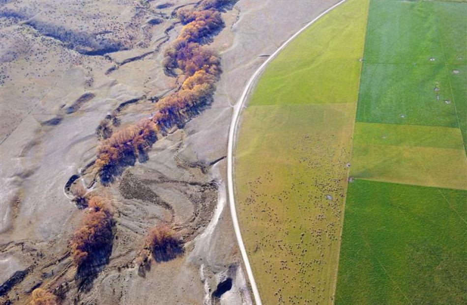 A dramatic illustration of how water can transform Central Otago farmland. This photo of...