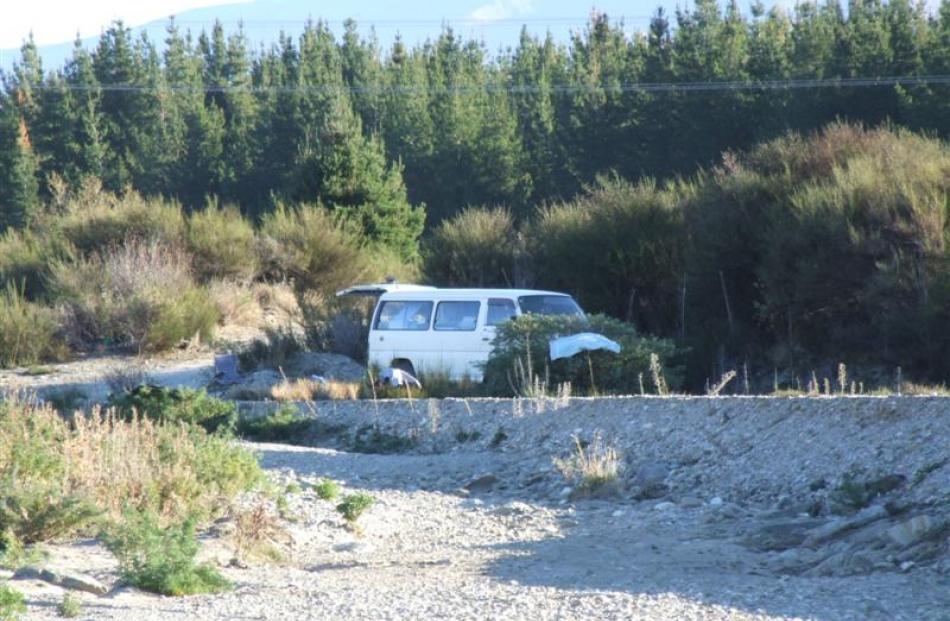A freedom camper seen parked at a secluded site near the Ballantyne Rd bridge across the Cardrona...