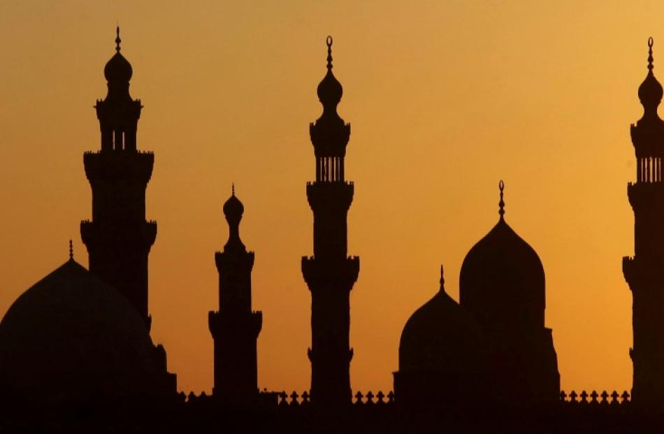 A general view of mosques during sunset in Old Cairo. Egyptians have voted on a constitution...
