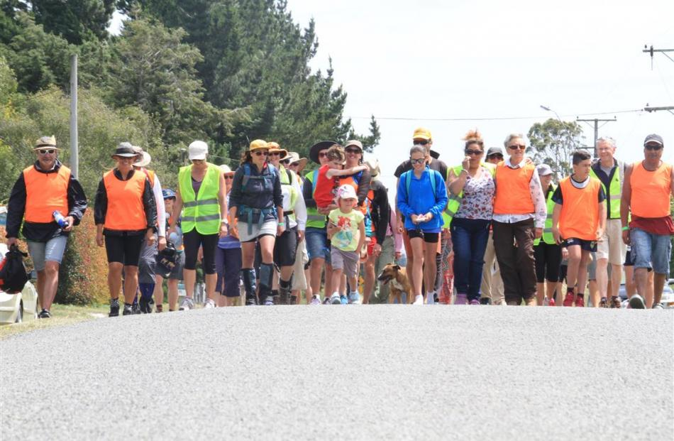 A group of about 40 people walk McPherson Rd, near the Waitaki River, on Thursday as part of a...