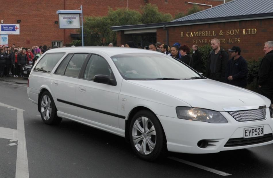 A hearse leaves the funeral of North Taieri brother and sister Shannon and Danielle Kiriau this...