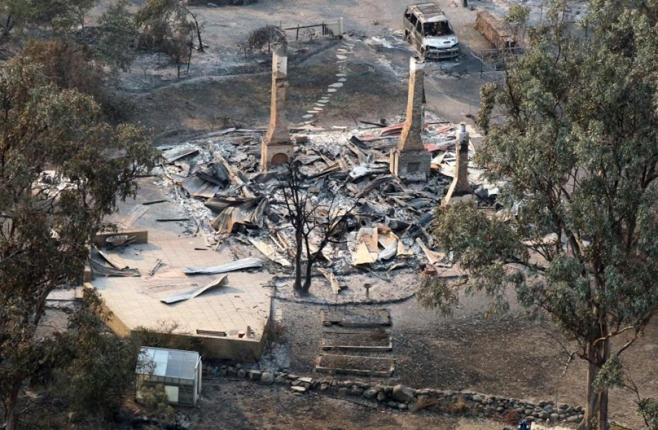 A house destroyed by a bushfire is seen in ruins in Dunalley, about 40km east of Hobart. Photo by...