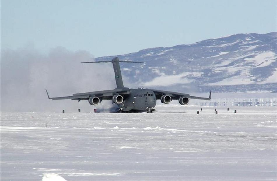 A huge C17 Globemaster 111 lands at Pegasus Airfield, near McMurdo Sound, in the Antarctic.