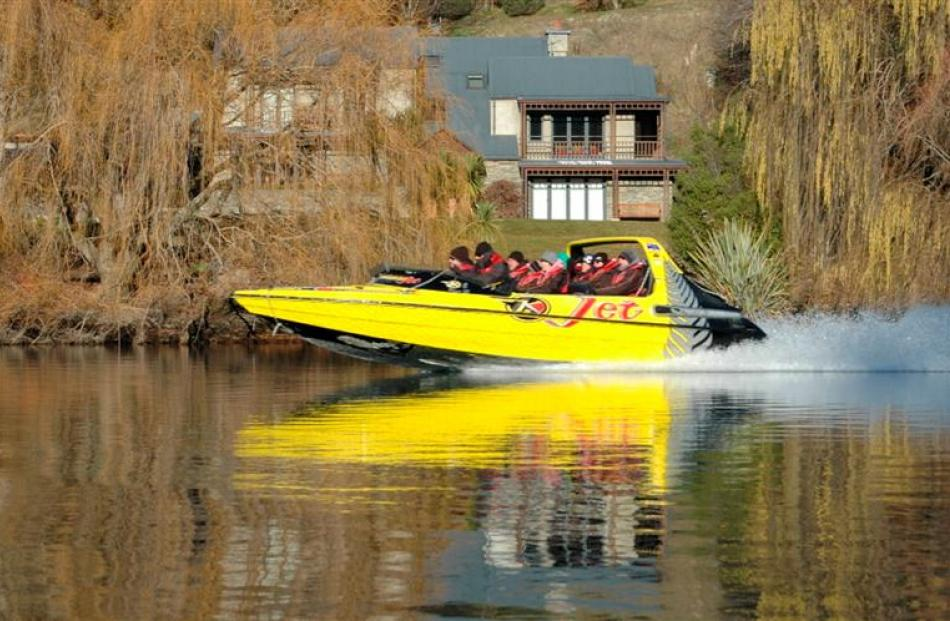 A Kawarau Jet boat passes Kawarau River resident Jo Boyd's property. Ms Boyd says there are...