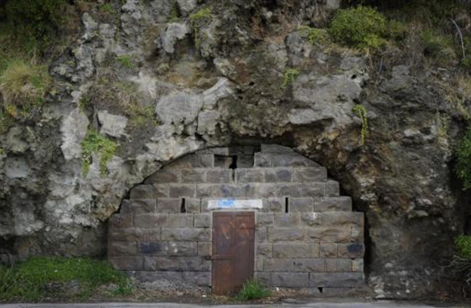 A locked door beside Portobello Rd, near the beginning of Otago Peninsula, leads to a cave once...