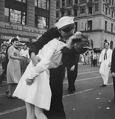 A man believed to be sailor Glenn McDuffie kisses a nurse in Times Square in an impromptu moment...