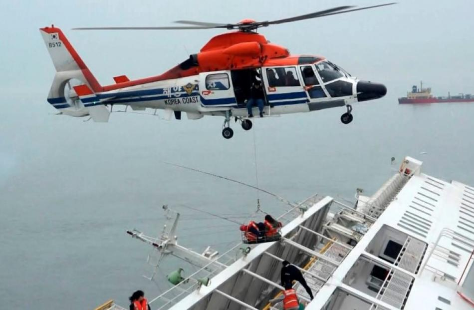 A maritime police helicopter crew rescues passengers from the capsized ferry. REUTERS/West...