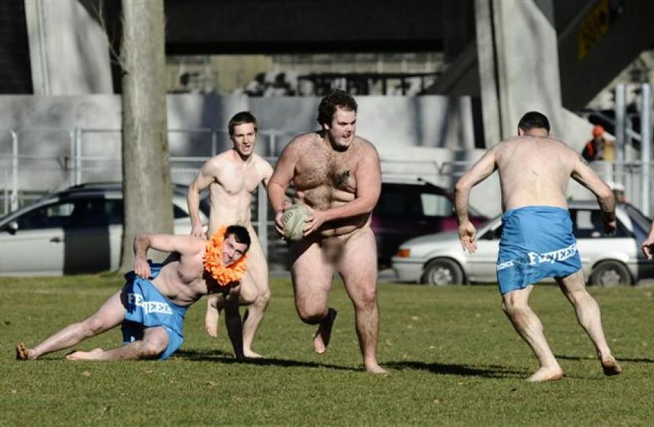 A member of the Nude Blacks attacks during the rugby match between the Nude Blacks and a Fijian...