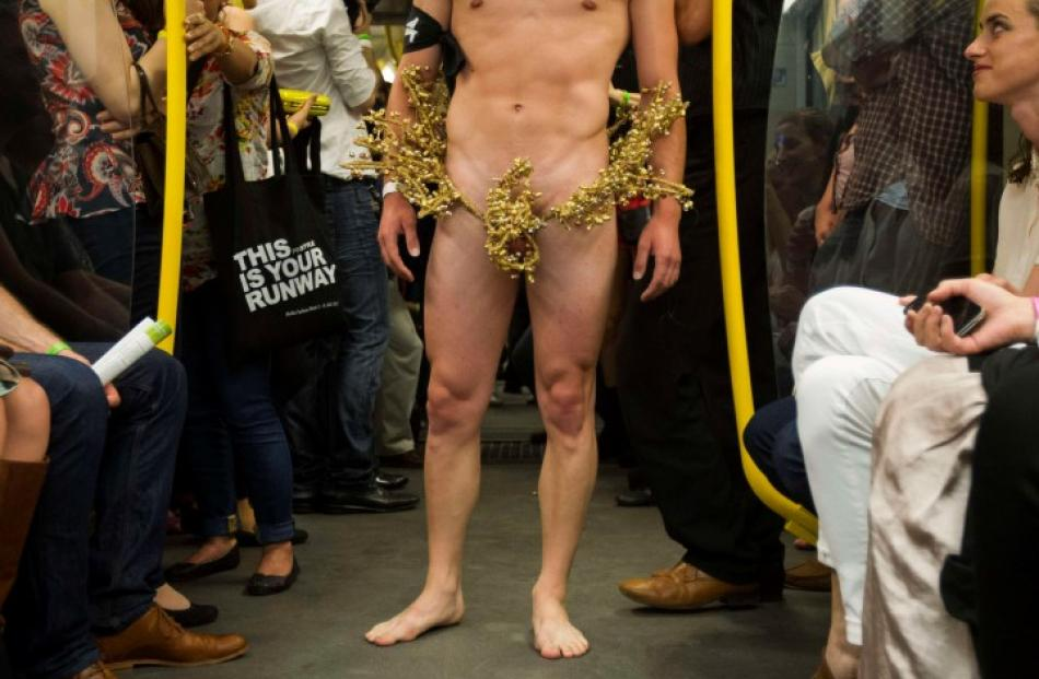 A model presents a creation during the 'Underground Catwalk' fashion show in a U-Bahn subway...