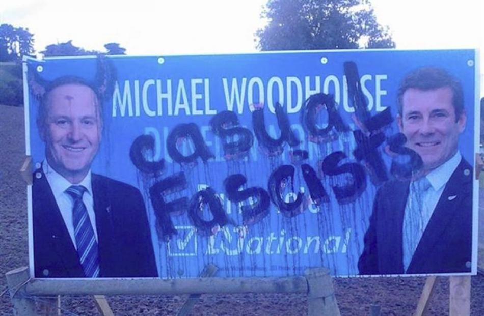 A National Party billboard featuring Dunedin North candidate Michael Woodhouse and Prime Minister...