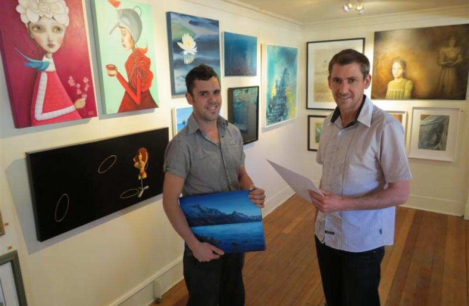 A painting by Queenstown Art Society studio artist Hamish McBride (left) is one of 104 pieces...