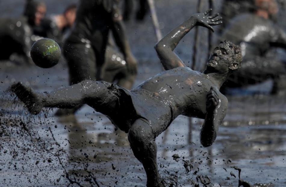 A participant loses his footing during a handball match. REUTERS/Morris Mac Matzen
